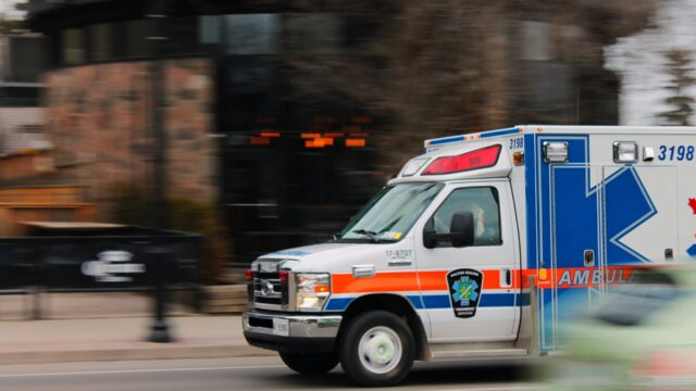 ambulance speeds down a city street