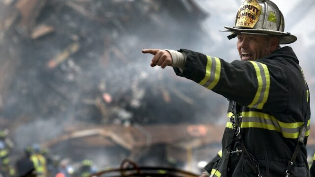 Firefighter in front of wreckage
