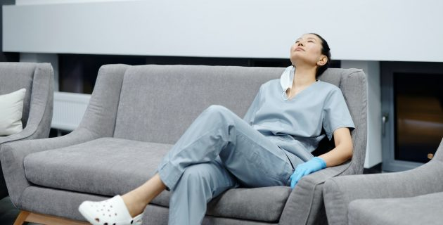 exhausted nurse rests on a couch