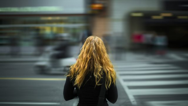 Girl looks at busy street