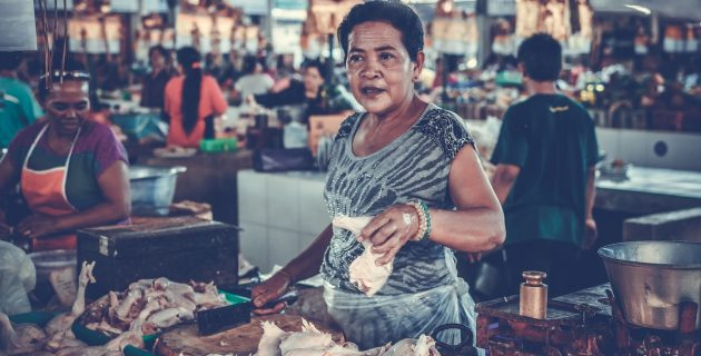 a woman sells meat in a market in Marga, Indonesia