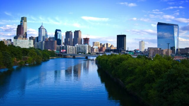 Philadelphia behind river and trees