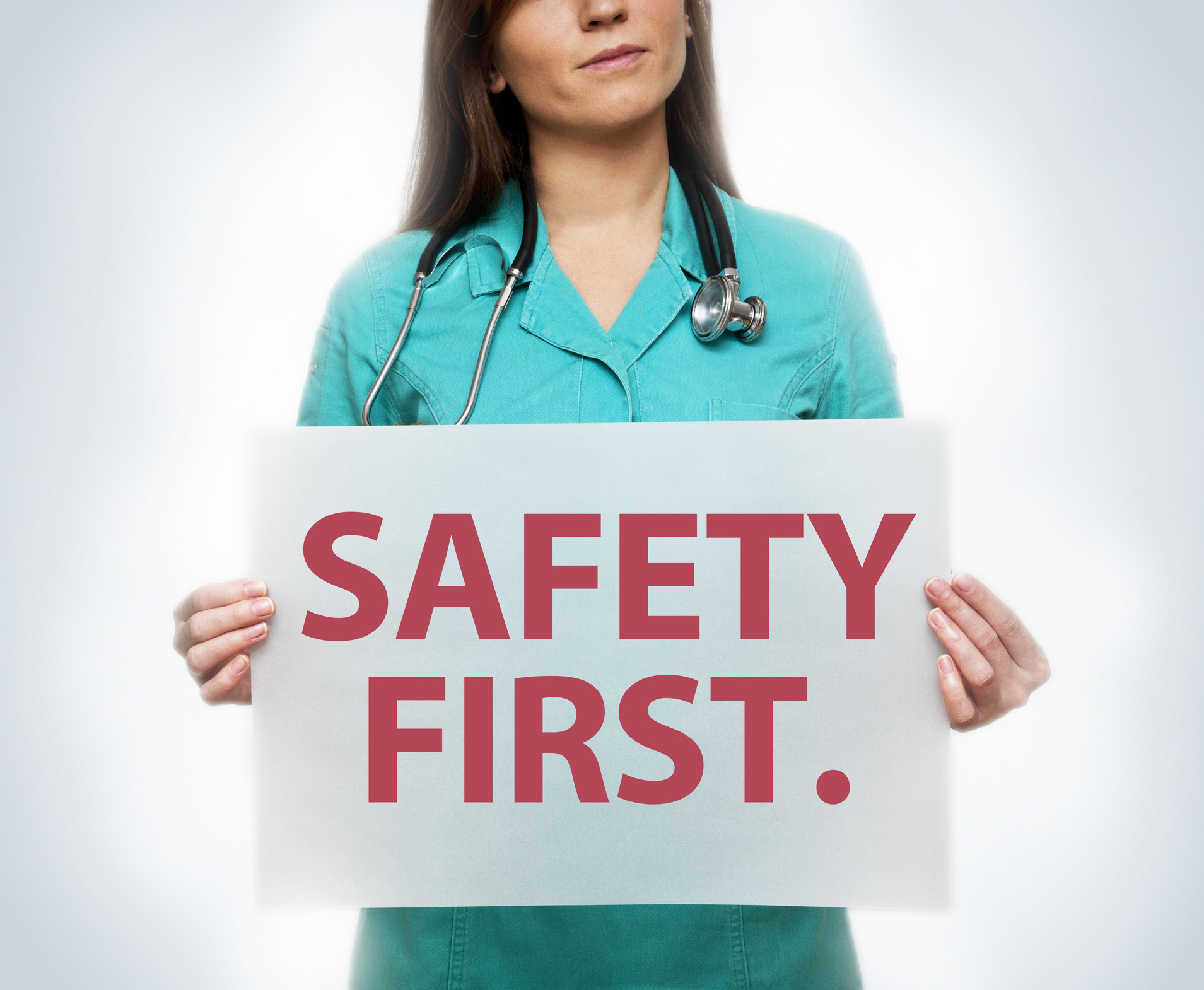 Doctor Holding Safety First Poster