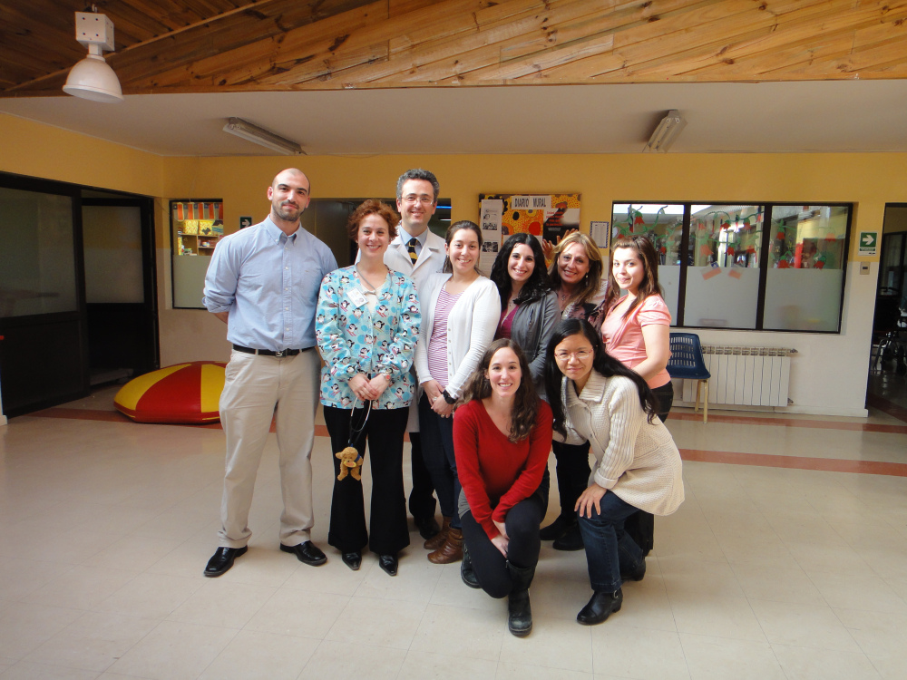 Dr. Xiaoli Chen (extreme right, front row) with some of our collaborators in Punta Arenas, Chile.  Dr. Juan Carlos Velez (back row, white coat) and Dr. Clarita Barbosa (2nd left) are co-investigators on the C-PASS projects.  Ms. Micah Pepper (in red shirt beside Dr. Chen) is the research coordinator.