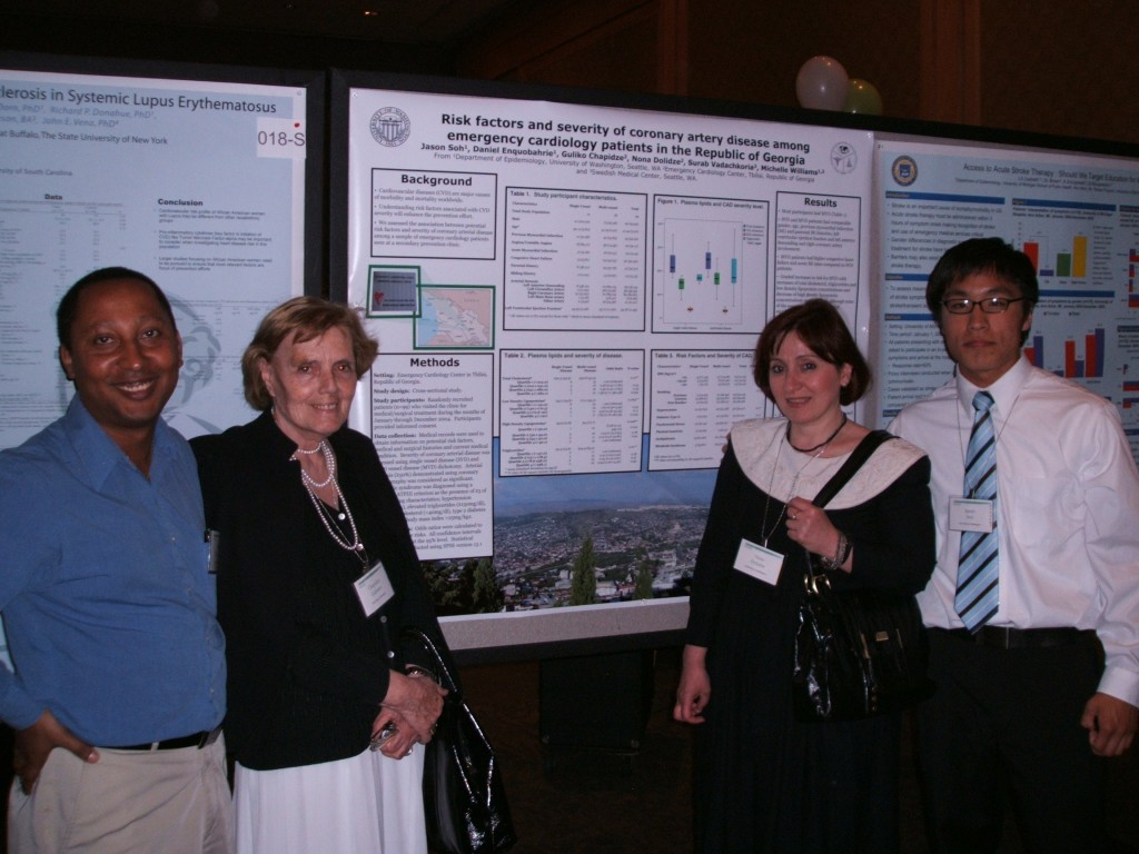 Faculty members from Republic of Georgia (center L to R: Dr. Guliko and Dr. Dolilidze) present collaborative posters with MIRT fellows, Dr. Daniel Enquobahrie (left) and Mr. Jason Soh (right).