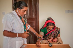Rong Mala and six-day-old, Rakhal, receive a postnatal check up at the government clinic built in Badulpur, Habijganj, Bangladesh. This clinic is already having a positive effect in transforming attitudes towards healthcare as, traditionally, the mother and child should not leave the house until one month after the birth. However, at just six-days-old Rong Mala is treading new ground in bringng Rakhal to the clinic. To mitigate this, her mother-in-law accompanied her to the clinic and she carriers a small bag of earth taken from the house, so that mother and child remain connected to the family home whilst they are away. Photo: CJ Clarke/Save the Children