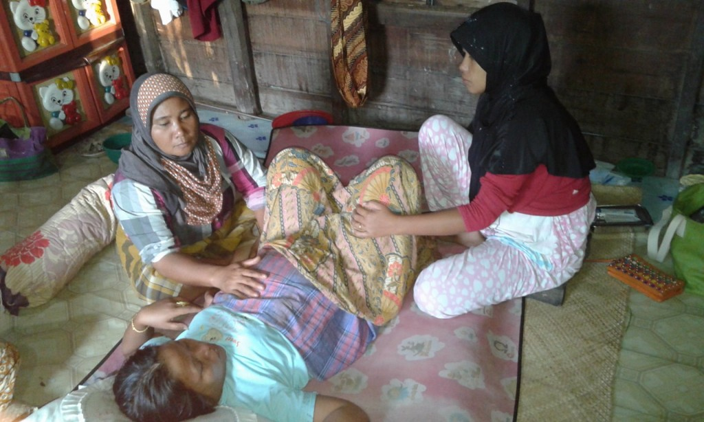 indonesia traditional birth attendant tba midwife maternal health mortality newborn governance Aceh Singkil woman giving birth home birth