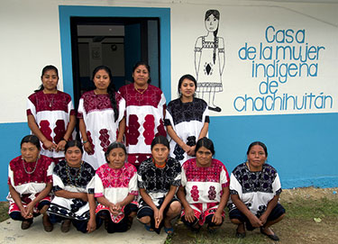 A group of midwives poses in front of their birth center in Chalchihuitan, Mexico