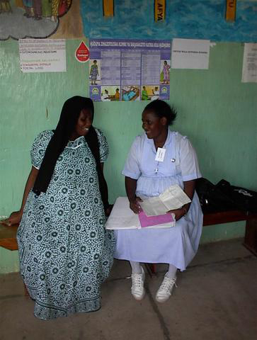 Trainee interviewing antenatal care client in Tanzania