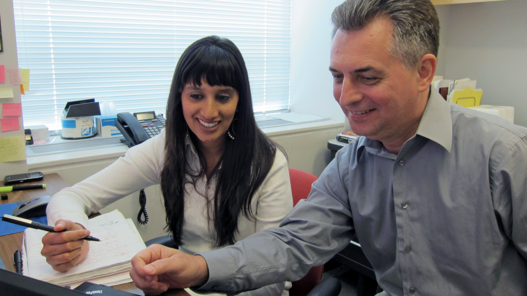 Dr. Vladimir Novitsky (right) advises PhD student Raabya Rossenkhan.