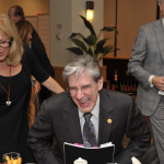 Dean Frenk enjoys a laugh with deeda Blair, Maurice Tempelsman, and Ellie Starr, Vice Dean of External Relations.