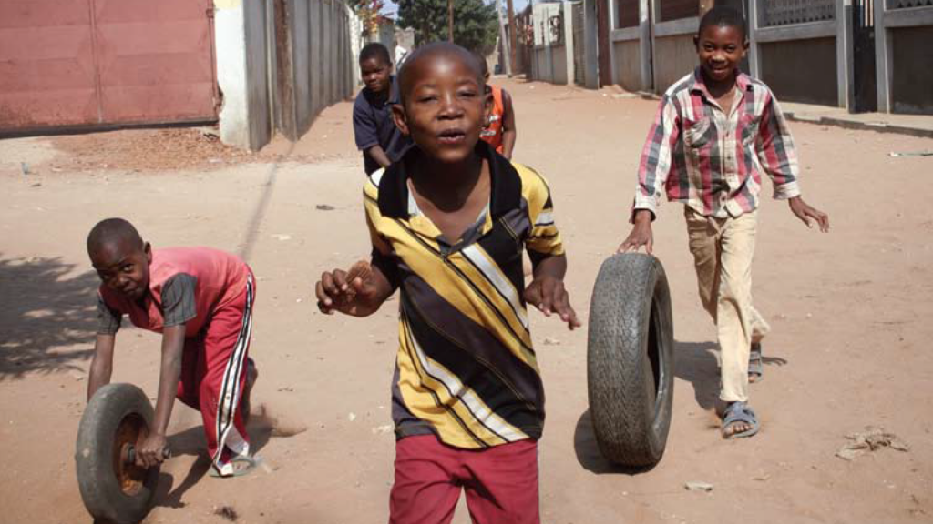 """""""Playing with Tires"""" 2007, Maputo, Mozambique Photo by Cecelia, age 13, courtesy Venice Arts©"""