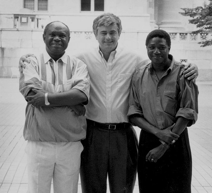 Max Essex, center, Souleymane Mboup, right, with a colleague.