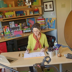 Image of Eve Wittenberg Filming in the GHELI Studio.