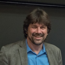 Uwe Siebert smiling.