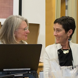 Eve Wittenberg and Lisa Prosser looking at each other, smiling, and in conversation.
