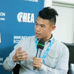 Christian Suharlim holding microphone and talking at iHEA