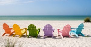 chairs in rainbow colors on beach