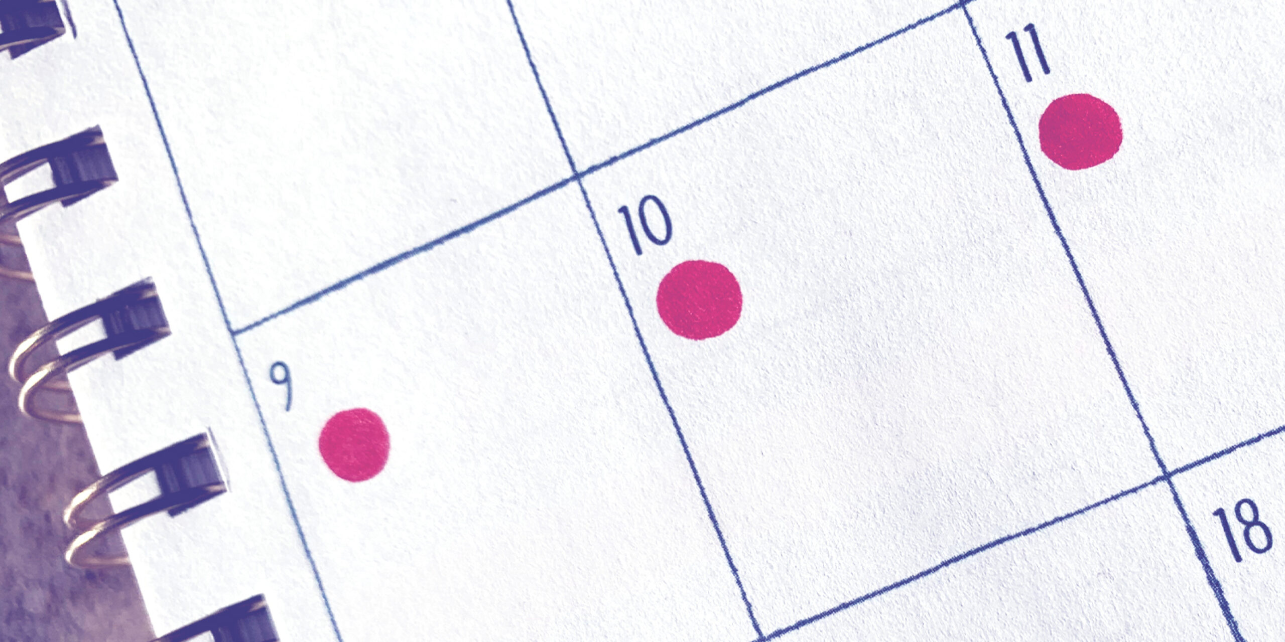 Red dots on a calendar signify when a person had their period.