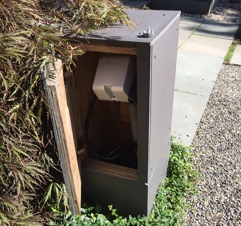 Charging station in a box with a door
