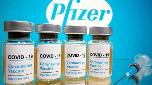 A row of COVID-19 vaccine bottles
