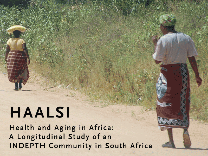 Two older women walk on a dirt road in rural South Africa