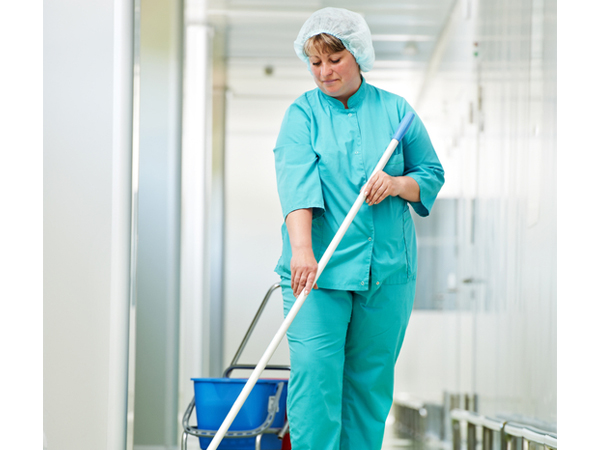 Woman mopping a floor at work