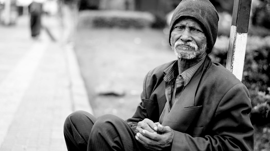 African American man sits on a bench