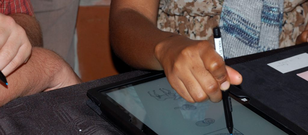 Digital tablets being used to train field workers as part of the HAALSI project