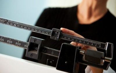 Measuring someone's weight on a scale