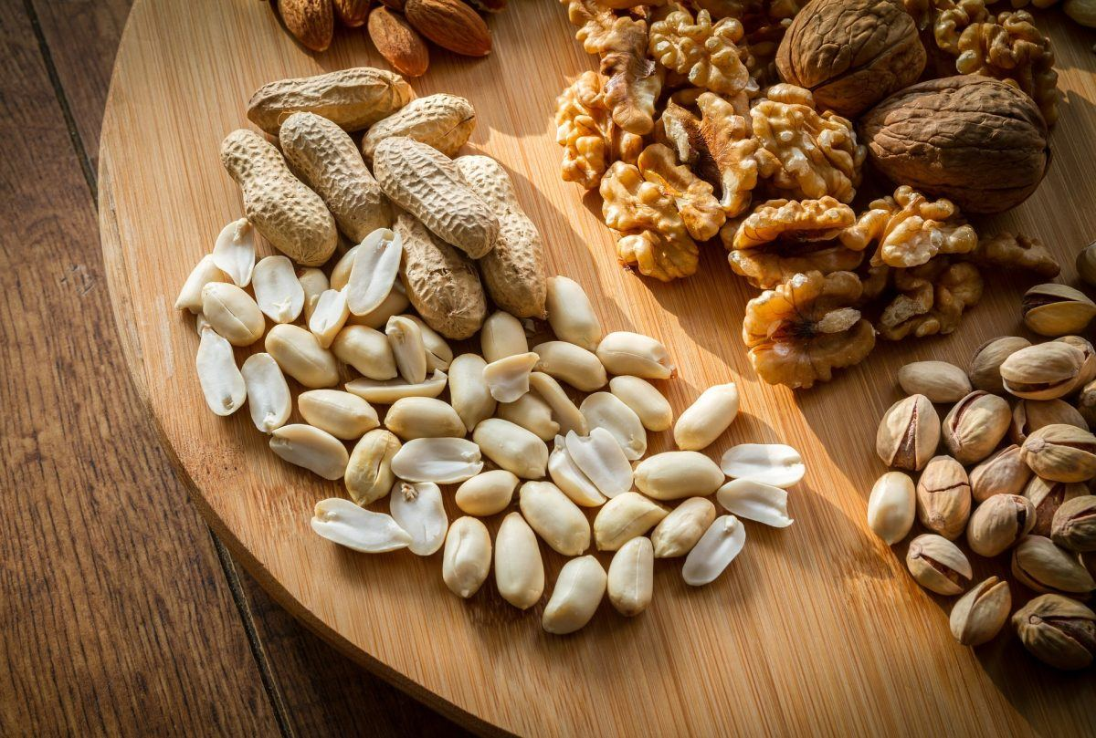 Mixed nuts, including peanuts, waltnuts, almonds, and pistachios