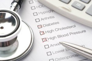 Medical conditions diabetes and cholesterol checked on a medical test result form