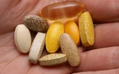 Multivitamins in the palm of a hand
