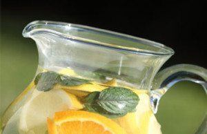 water pitcher with citrus slices and mint