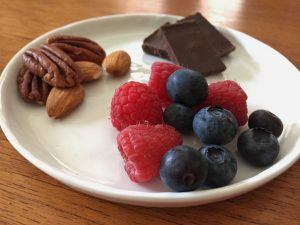 Raspberries, blueberries, dark chocolate, pecans, and almonds