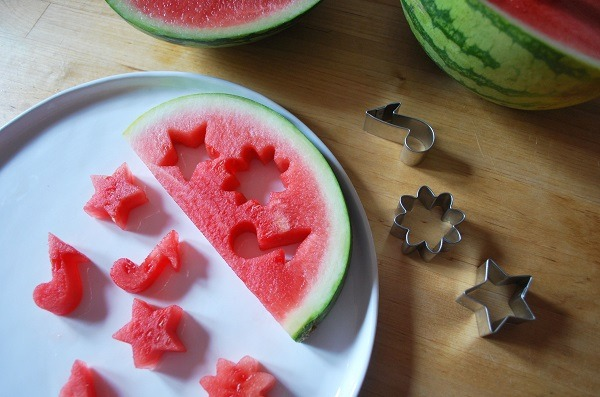 Watermelon slice with cut out shapes