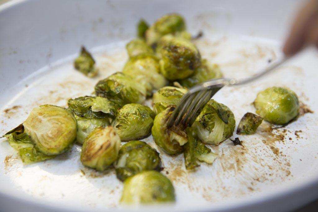 Roasted Brussels sprouts with a fork