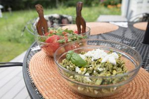 summer picnic salads set out on a table