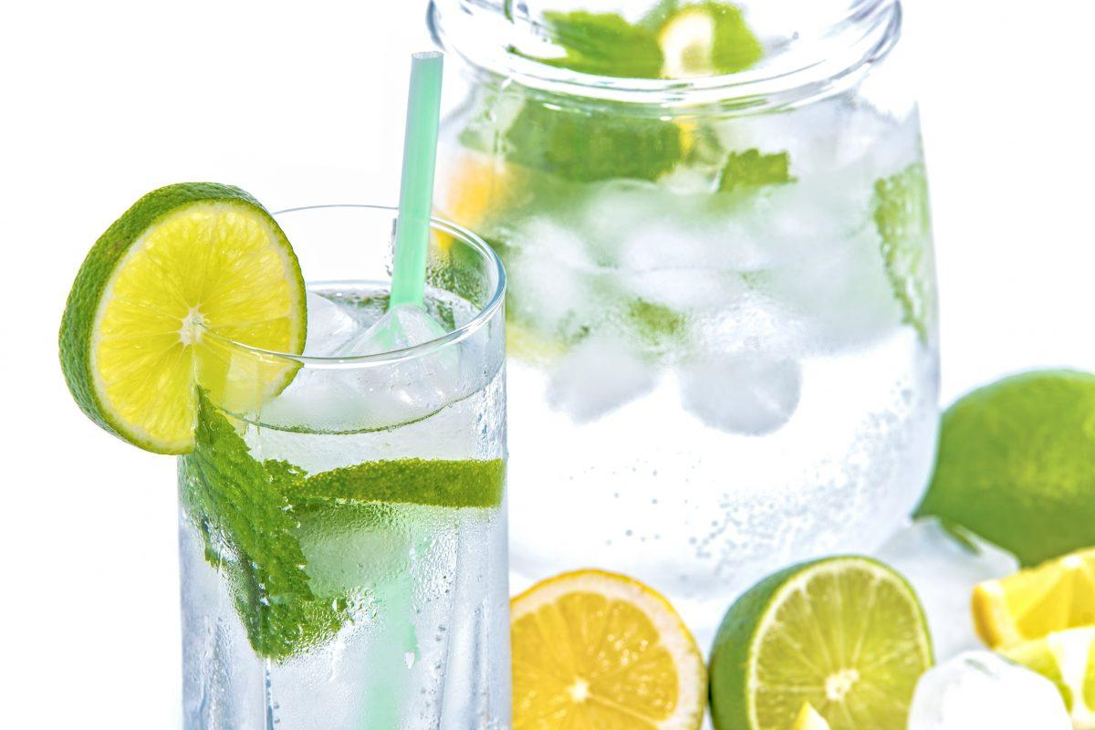 water with limes, lemons, mint, and ice