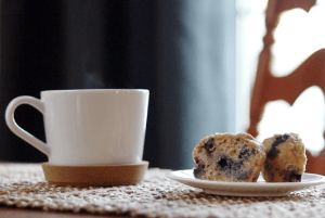 blueberry muffin with coffee cup