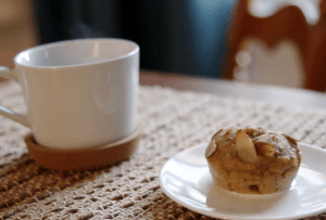 Chickpea lemon cardamom muffin with coffee cup
