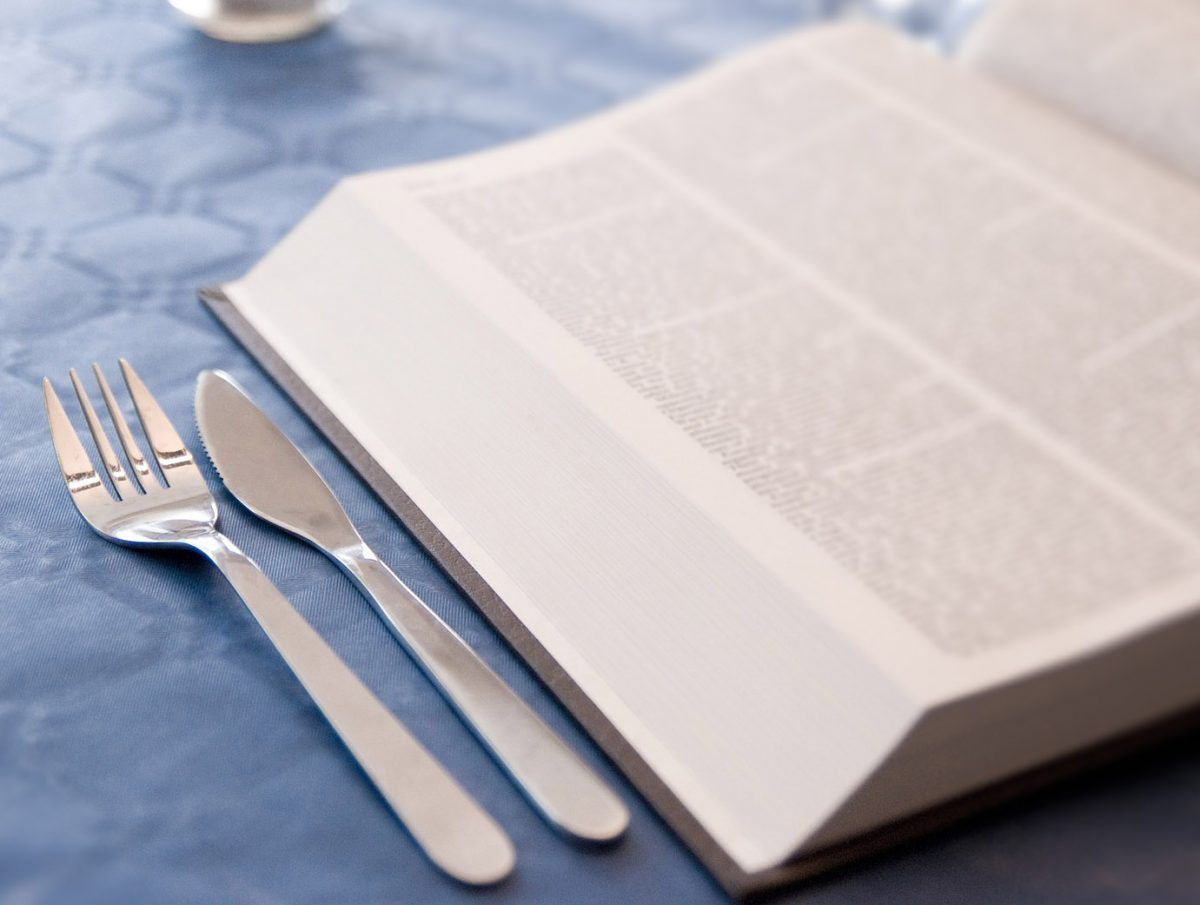 Diet book with fork and knife on table