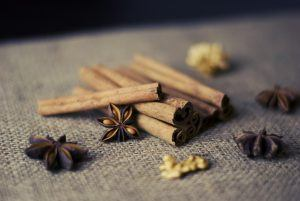 cinnamon sticks, nuts, and star anise