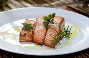 salmon with dill on a plate drizzled with olive oil