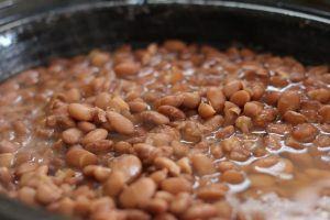 pinto beans soaking in a pot of water