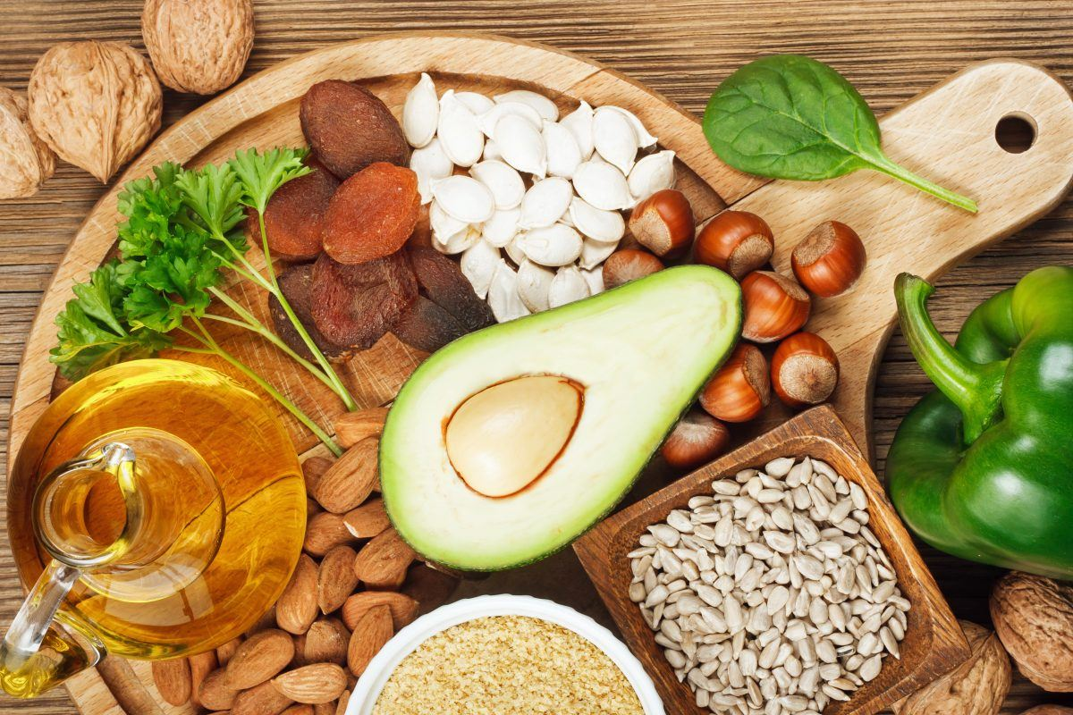 Foods rich in vitamin E such as wheat germ oil, dried wheat germ, dried apricots, hazelnuts, almonds, parsley leaves, avocado, walnuts, pumpkin seeds, sunflower seeds, spinach and bell pepper
