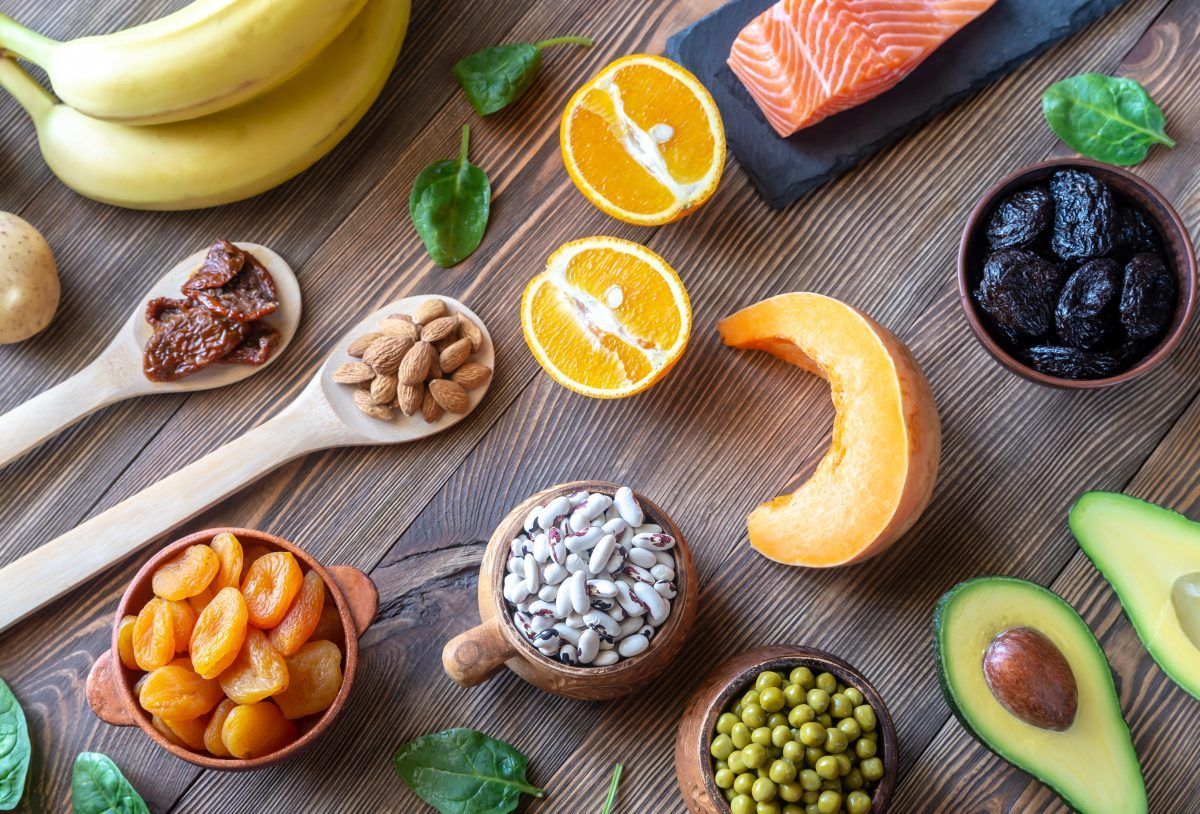 Potassium foods including bananas, almonds, dried fruit, beans, avocado, cantaloupe, salmon, spinach