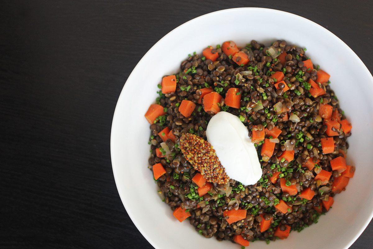 French style lentils cooked with carrots, shallots, olive oil, and topped with whole grain mustard, chives, and some creme fraiche.