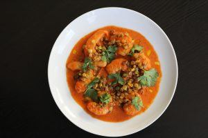 Shrimp with red curry and crispy sprouted lentils