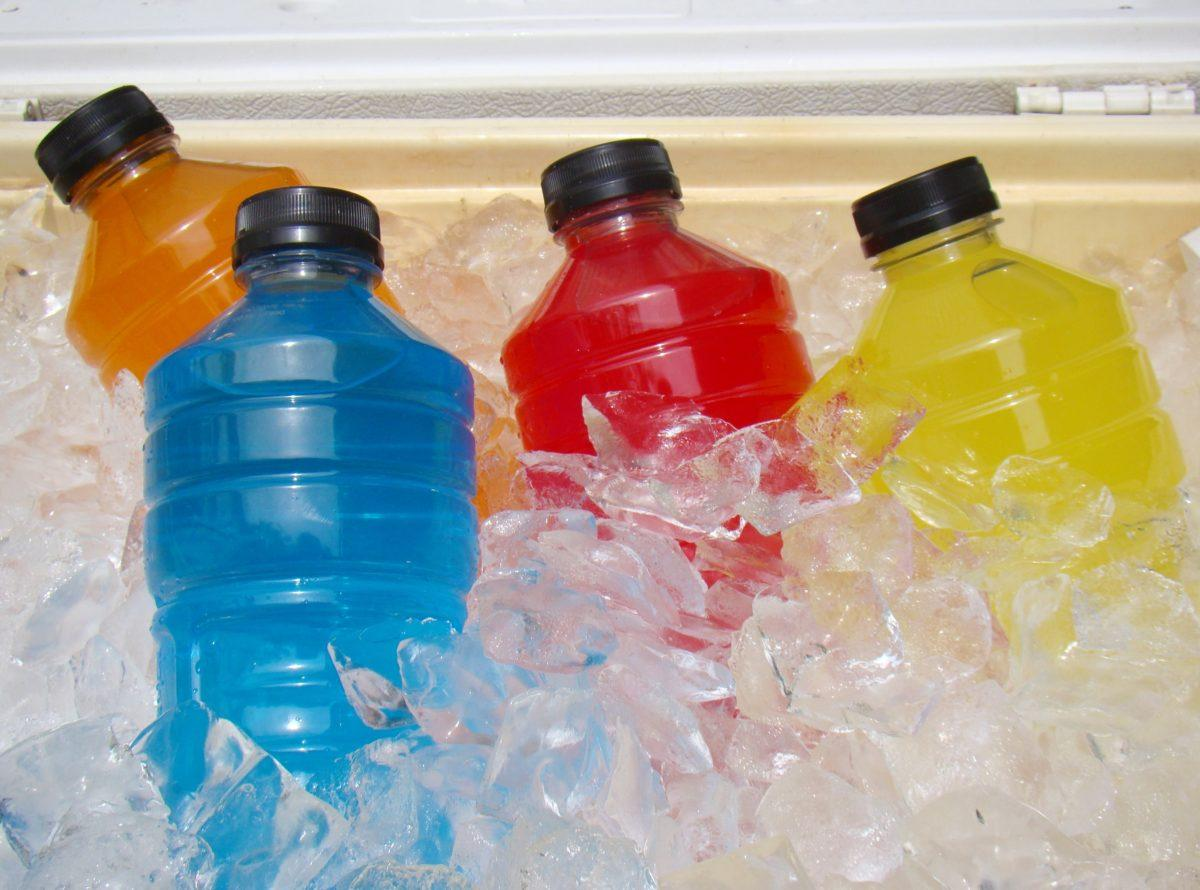 blue, orange, red, and yellow colored sports drinks on ice
